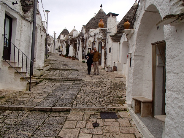 Walking up a street lined with trulli