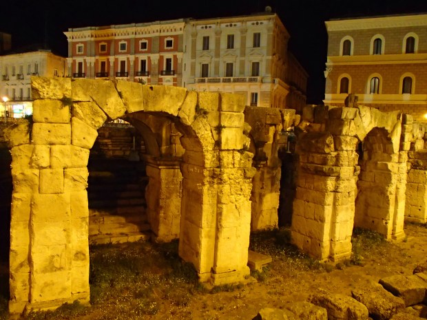 Part of the Roman Amphitheater illuminated at night.